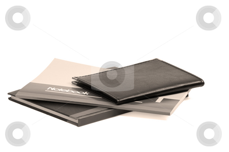 Notebooks stock photo, Assorted notebooks flat piled on white background,sepia filter by Francesco Perre