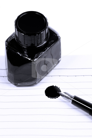 Fountain pen and notebook stock photo, Classic black fountain pen on open notebook with ink bottle with stain on page,blue filter by Francesco Perre