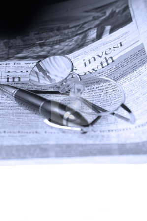 Pen and glasses and newspaper stock photo, Pen and glassesand newspaper over white glass table by Francesco Perre