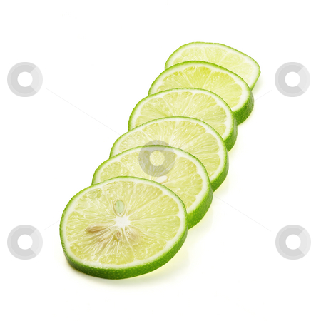 Lime stock photo, Green fresh lime slices isolated over white background by Francesco Perre