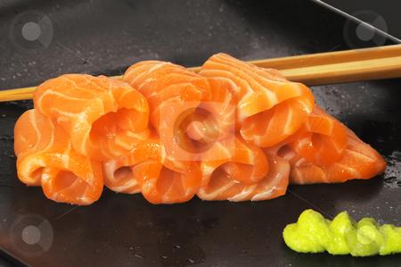 Salmon sushi stock photo, Slice of salmon sushi with wasabi sauce by Francesco Perre