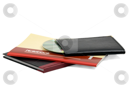 Notebooks stock photo, Assorted notebooks with a cd flat piled on white background by Francesco Perre