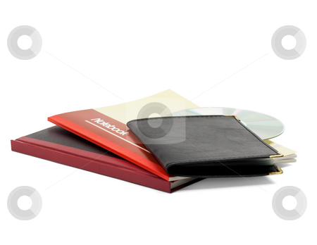Notebooks stock photo, Assorted notebooks and cd isolated on white background by Francesco Perre
