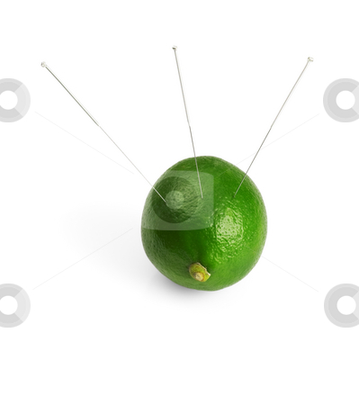 Lime and needle stock photo, Lime with acupuncture needles isolated on white background by Francesco Perre