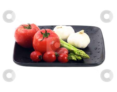 Mediterranean vegetables stock photo, Plate of fresh tomatoes ;cherry tomatoes asparagus and garlic ,typical mediterranean food by Francesco Perre