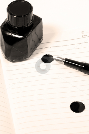 Fountain pen and notebook stock photo, Classic black fountain pen on open notebook with ink bottle with stain on page,sepia filter by Francesco Perre