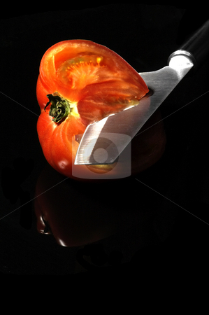 Tomato sliced stock photo, Tomato sliced with knife on black background by Francesco Perre