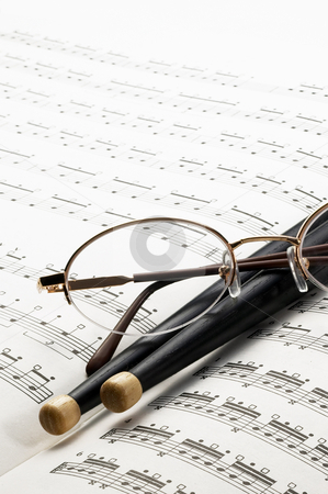 Music charts stock photo, Music charts ,with drums stick and glasses on top by Francesco Perre