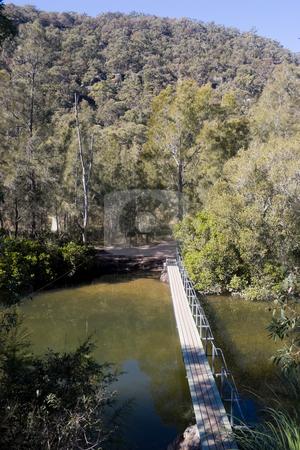 Footbridge stock photo, Foot bridge over a river by Nicholas Rjabow