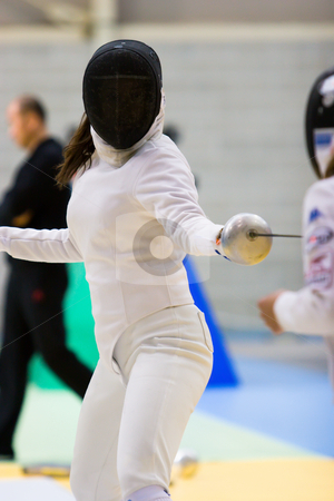 Fencer stock photo, A fencer in a stance by Nicholas Rjabow