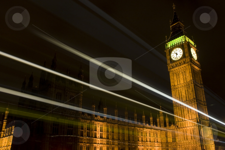 Westminster Tower/Big Ben at night with light trails stock photo, Westminster Tower/Big Ben in London, UK at night with light trails of passing vehicles by Steve Smith
