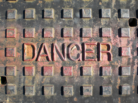 Manhole cover stock photo,  by J.G. Byers