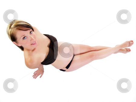 Young pregnant woman from above on white background stock photo, Woman with large tummy and black top and bottom by Jeff Cleveland