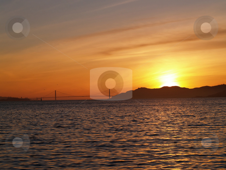 Sunset Golden Gate Bridge and Bay from Berkeley stock photo, Sun Setting near Golden Gate Bridger San Francisco Bay by Jeff Cleveland