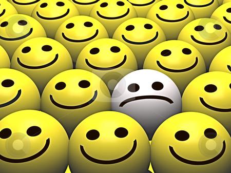 Happy faces surrounding Sad smiley stock photo