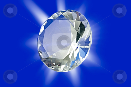Diamond stock photo, A photo of a diamond on a blue background with starburst by Norma Cornes