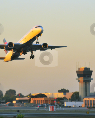Aircraft taking off stock photo, Aircraft taking off at Jowh Wayne airport Orange County California by Timothy OLeary