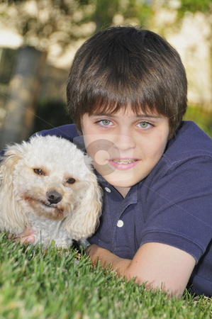 Young teenager and his dog stock photo, Young teenager and his best friend by Timothy OLeary