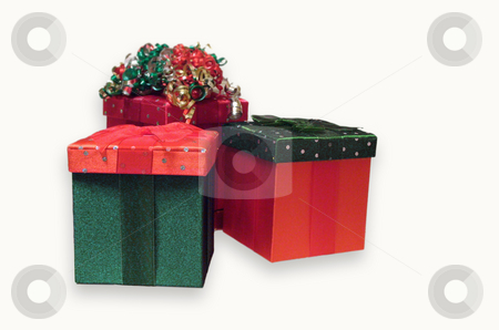 Christmas Gifts stock photo, Photo of 3 decorated velvet gift boxes in Christmas colors of red and green, one with festive holiday bow on top.  Isolated on white background. by Teri Francis Mazzafro