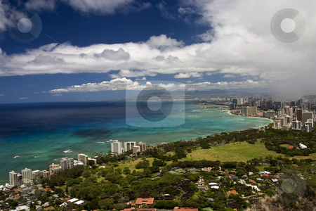 Honolulu and Waikiki Beach stock photo, A rain shower approachs Honolulu, HA aid Waikiki beach. by Marc Saegesser