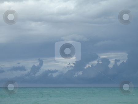Turquoise ocean and dark blue sky stock photo, Turquoise ocean and dark blue sky by Mbudley Mbudley