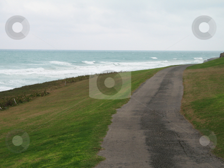 Rural road by the ocean stock photo, Rural road by the ocean by Mbudley Mbudley