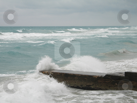 Stormy tropical ocean crashing on the coast stock photo, Stormy tropical ocean crashing on the coast by Mbudley Mbudley