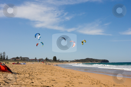 Kite Surfing At The Beach stock photo, A beach scene with surf kites in the air by Nicholas Rjabow