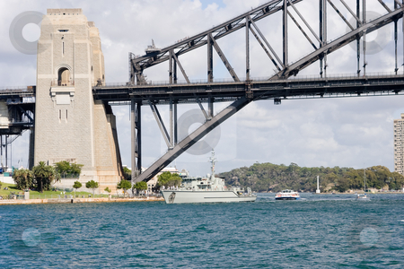 Bridge and Warship stock photo, The sydney harbour bridge and a naval patrol boat by Nicholas Rjabow