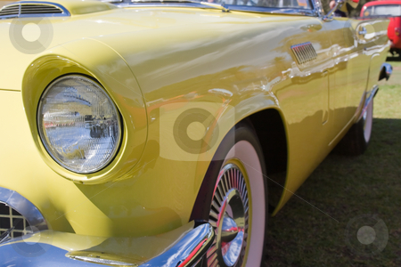 Yellow Car stock photo, Front headlight view of a yellow car by Nicholas Rjabow