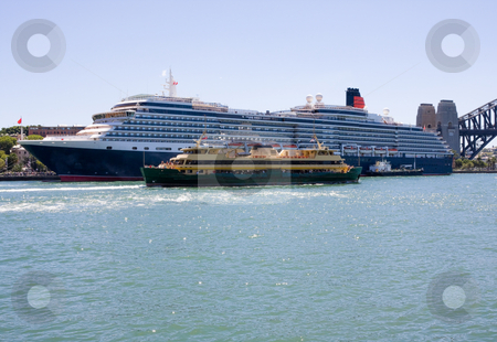 Ferry and Cruise Ship stock photo, A ferry dwarfed by a cruise ship by Nicholas Rjabow