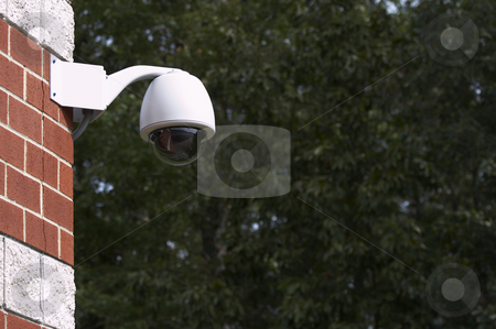 Security camera stock photo, A picture of a surveillance camera on a brick wall by Glen Jones