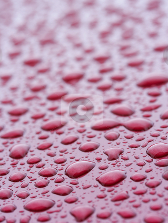 Water red stock photo, A picture of water drops on a red metal surface by Glen Jones