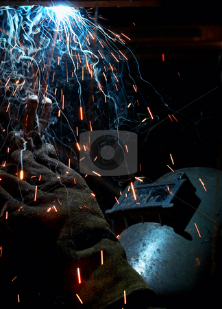 Welding color stock photo, A picture of a welder working at night by Glen Jones