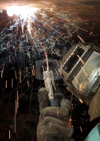 Hot handed stock photo, A welder working at shipyard under vessel by Glen Jones
