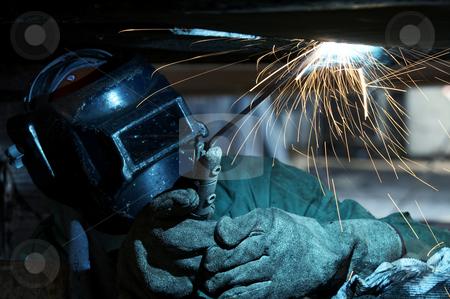 Blue weld stock photo, A welder working at shipyard during day by Glen Jones