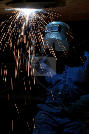 Burning rods stock photo, A welder working at shipyard at night by Glen Jones