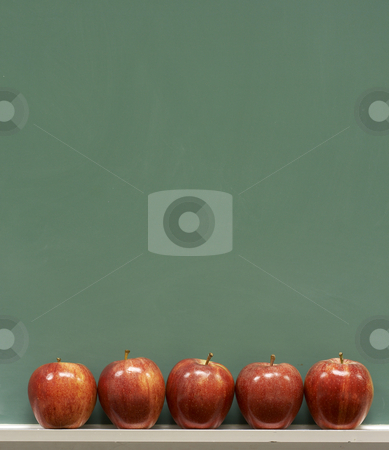 School and apples stock photo, Red apples on chalkboard in school classroom by Glen Jones
