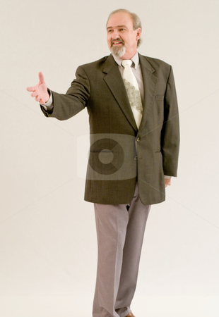 Shake and a smile stock photo, Businessman greeting a client with a smile by RCarner Photography