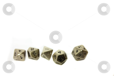 Small Metal Dice in a Row stock photo, Small metal dice in a row on a white background. Copy space. by Julie Bentz