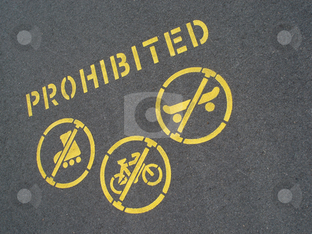 No cycling or skating stock photo, No cycling and skating sign stencilled on a pavement by Stephen Gibson
