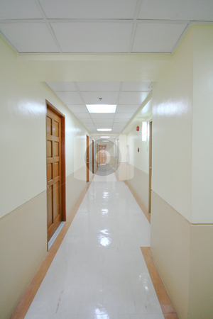 Hallway stock photo, Long hallway in a big condominium by Jonas Marcos San Luis