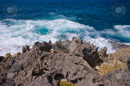 Rocky shore  stock photo, Rocky shore with ocean waves by Karin Claus
