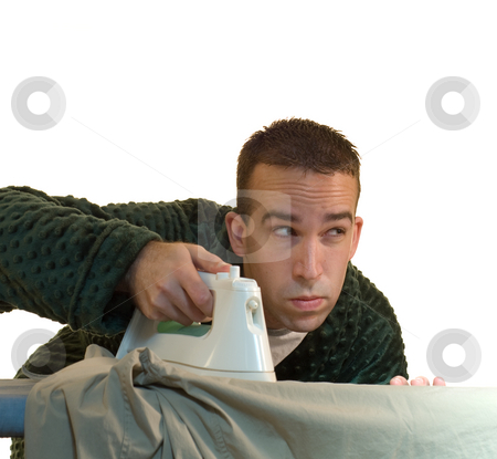 Laundry stock photo, A man doing his laundry and ironing his clothes by Richard Nelson