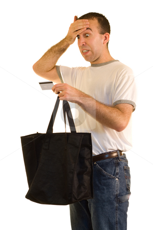 Credit Card Debt stock photo, A man looking at his credit card realizing he overspent by Richard Nelson