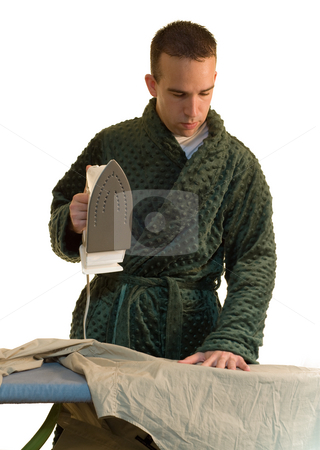 Man Ironing stock photo, A man ironing his shirt for work by Richard Nelson