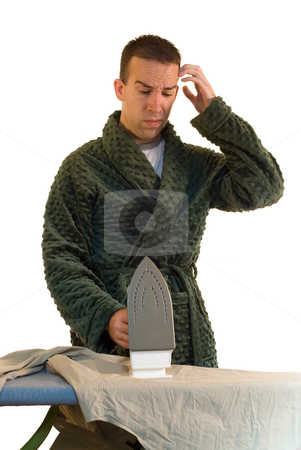 Swapping Chores stock photo, A man looking confused at how to do the ironing by Richard Nelson