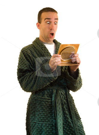 Surprised stock photo, A man looking surprised in the mirror by Richard Nelson