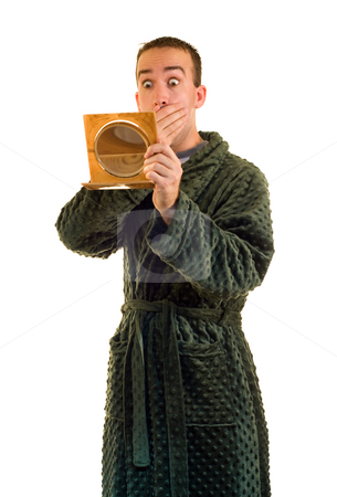 Morning Surprise stock photo, A man looking in a small mirror looking surprised by Richard Nelson