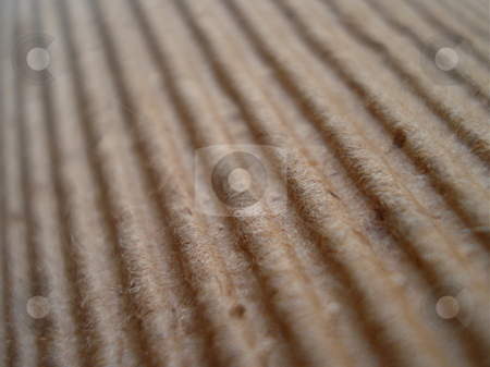 Natural Fiber Background stock photo, A cardboard fiber background reveals a pattern of ridges in the evening sunlight. by Ben O'Neal